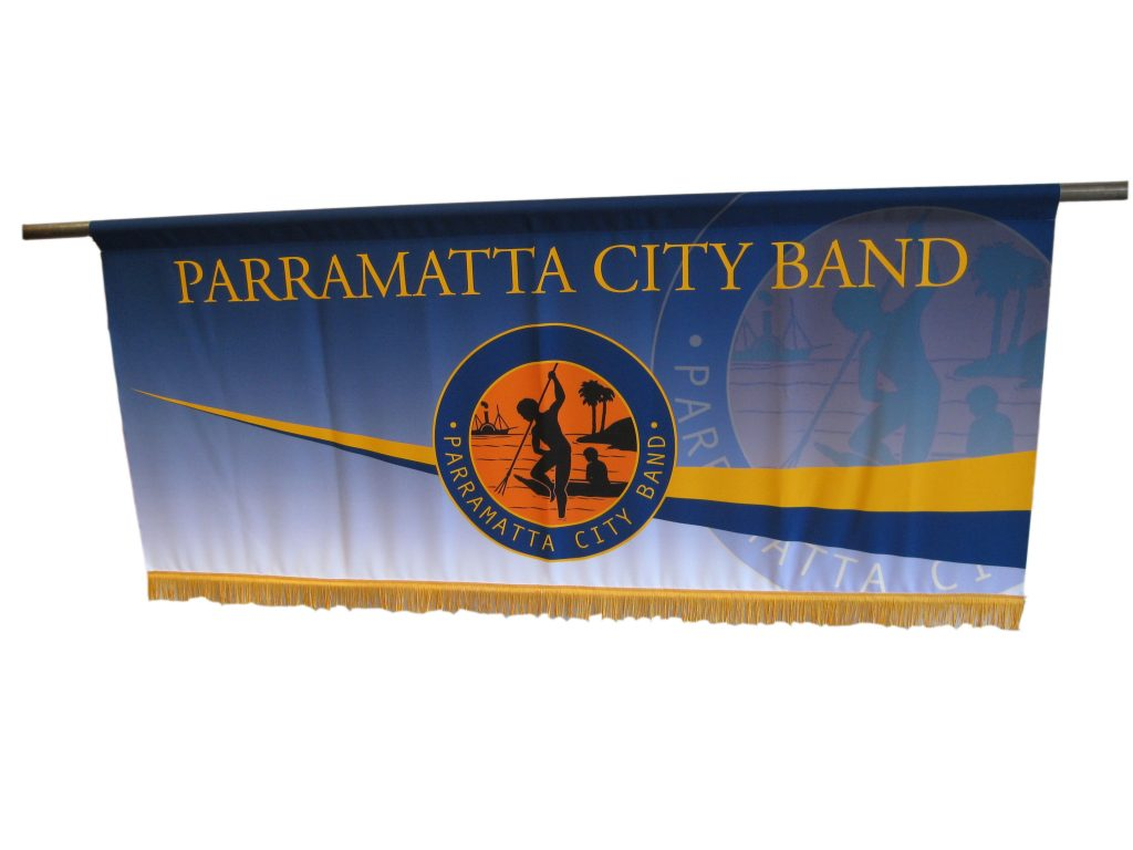 Picture of Marching Banner with fringe along bottom edge and rod to carry with it at the top edge, Indigenous design for Parramatta City Band